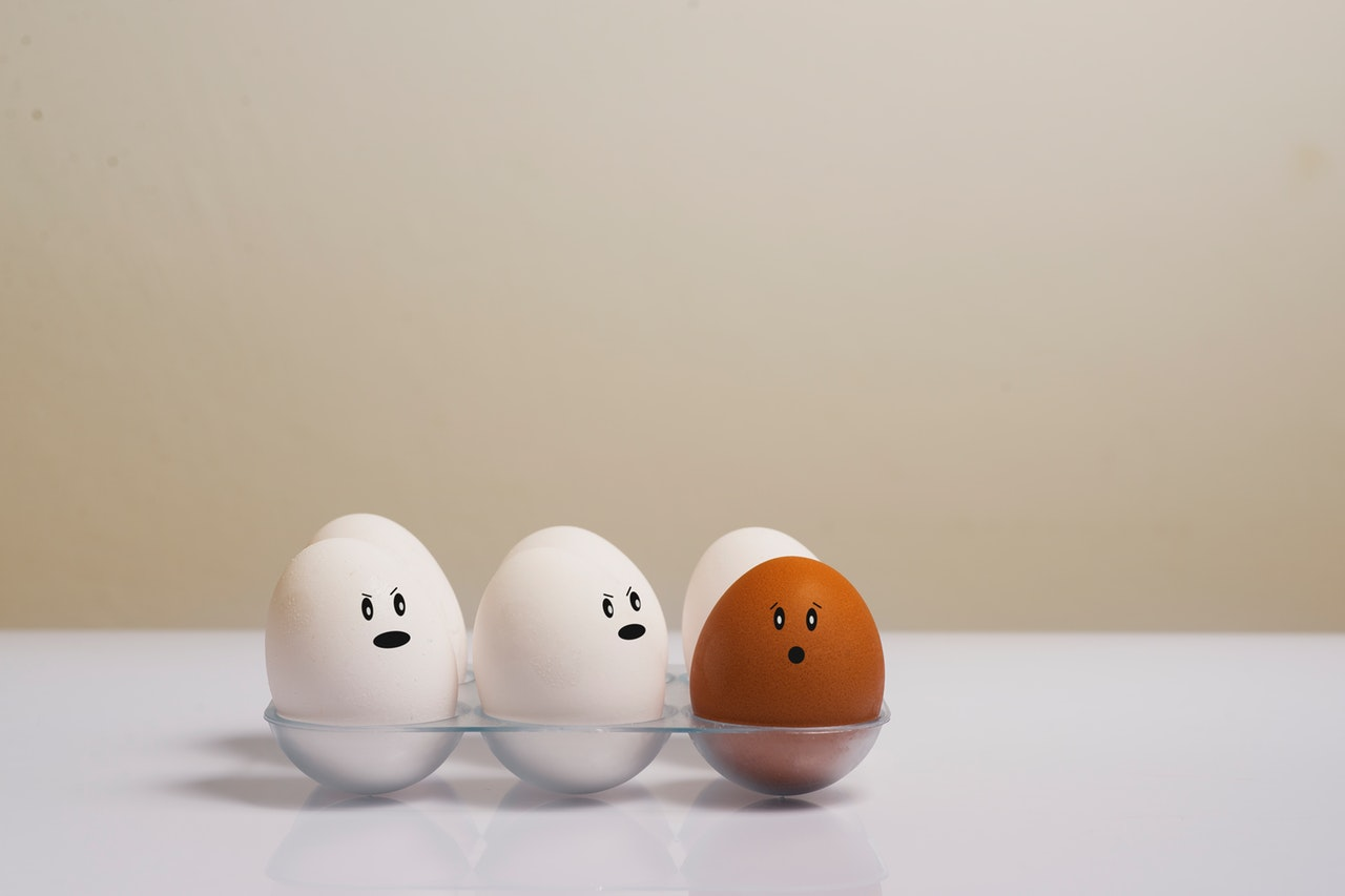 eggs-in-tray-on-white-surface